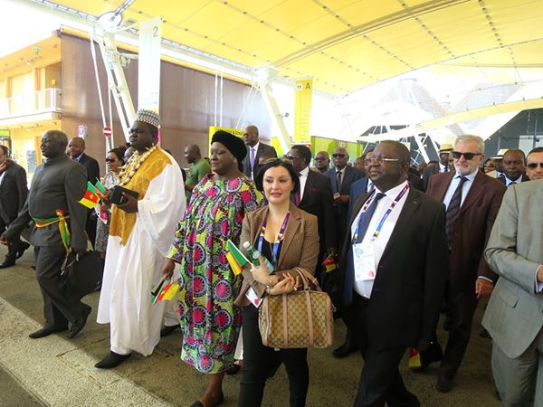 H.E Luc Magloire Mbarga, Minister of Trade (right) steering Cameroon's delegation to the National Day Celebration.